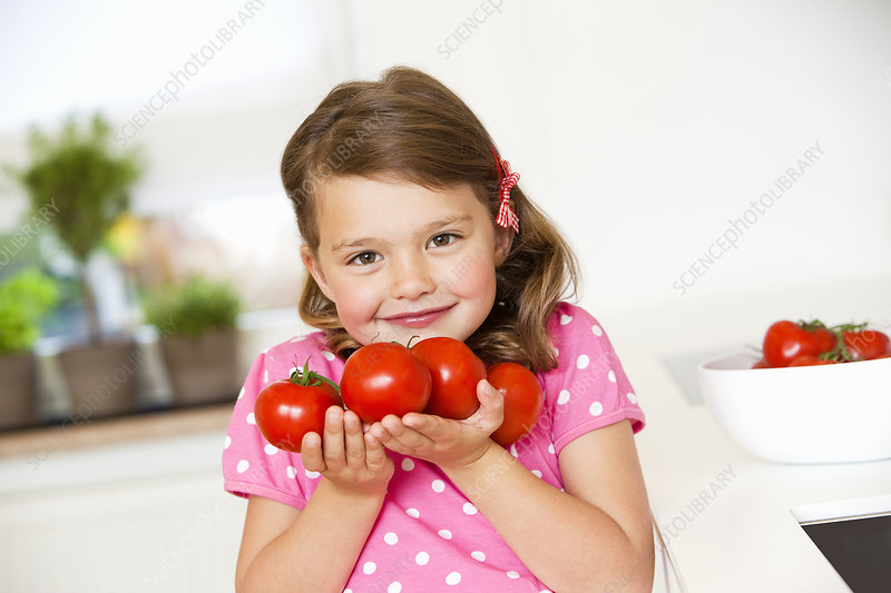 Girl with tomatoes