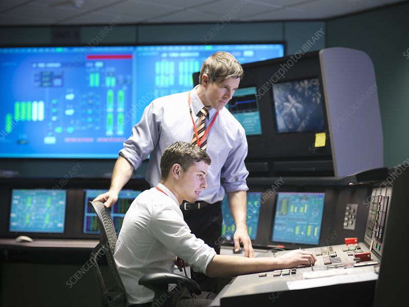 Operators in power station control room