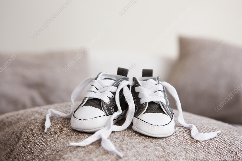 Baby shoes on pillow