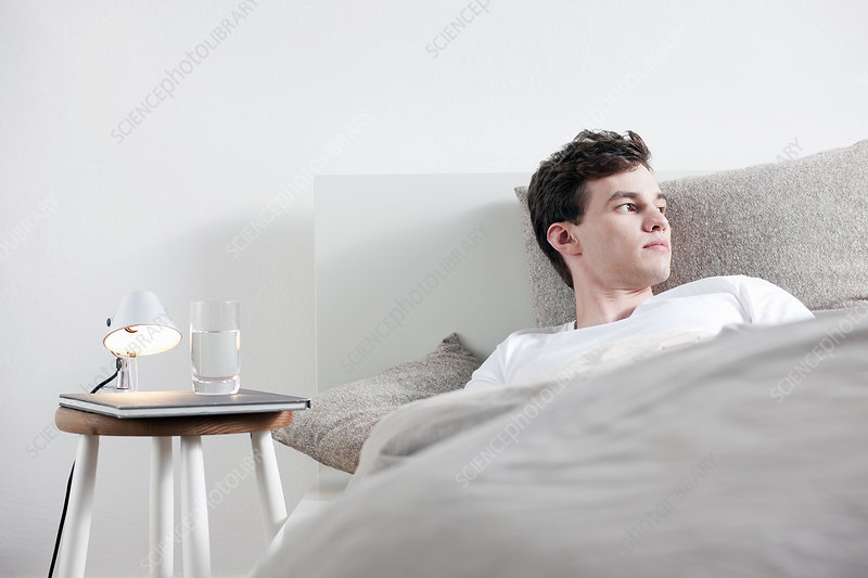 Man Laying In Bed Stock Image F004 0994 Science Photo