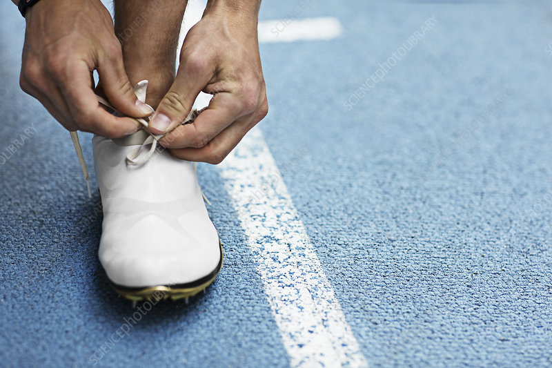 Runner tying shoelaces