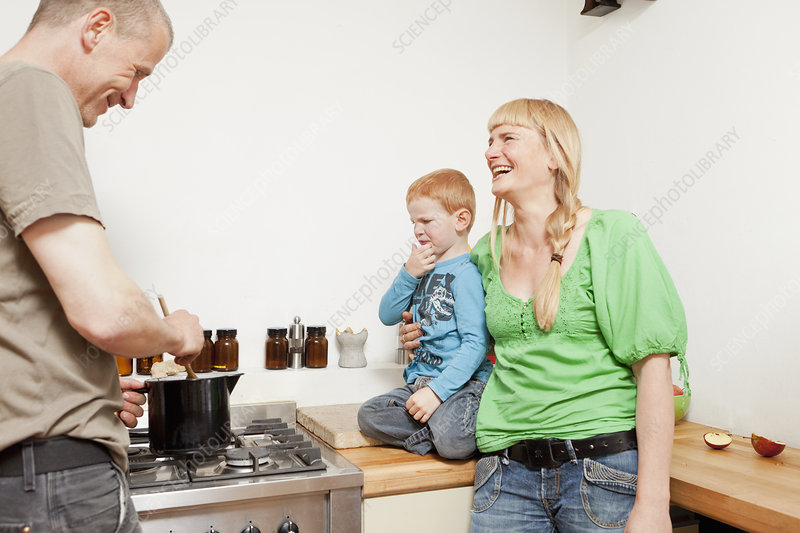 Parents cooking for reluctant son