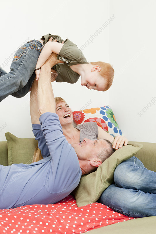 Family playing together on sofa