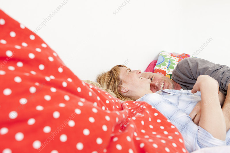 smiling couple laying in bed together stock image f004 1038 science photo library. Black Bedroom Furniture Sets. Home Design Ideas