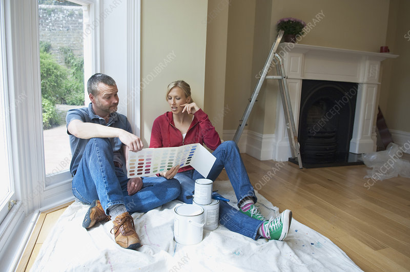 Couple choosing paint colors in new home
