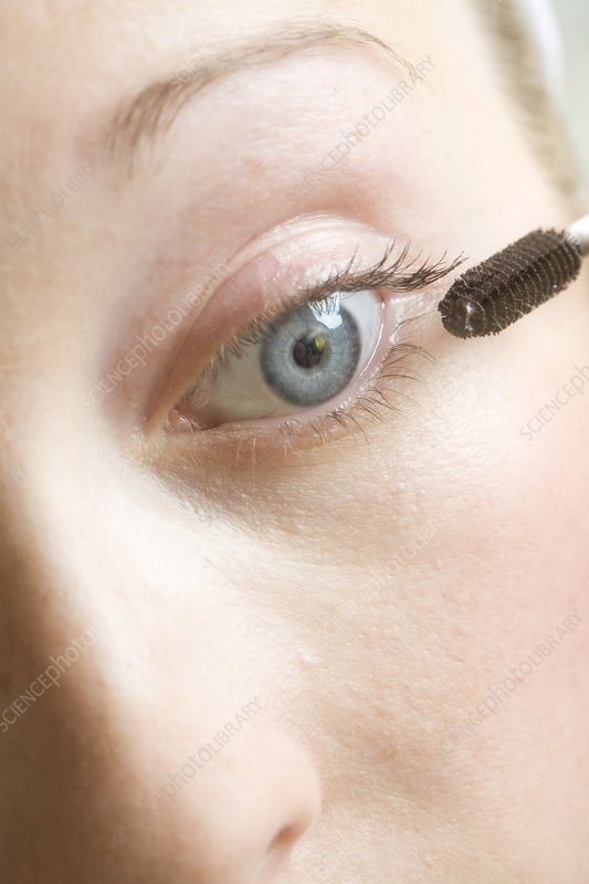 Close up of woman applying mascara