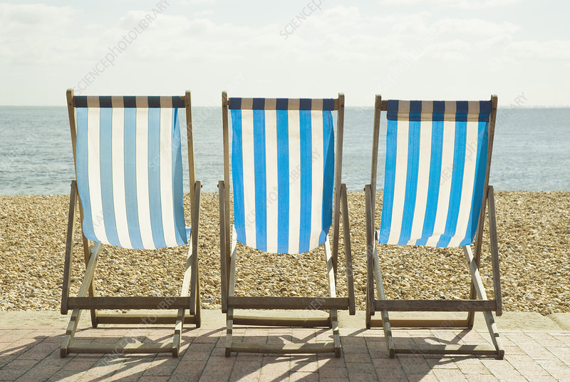 Striped lawn chairs on beach