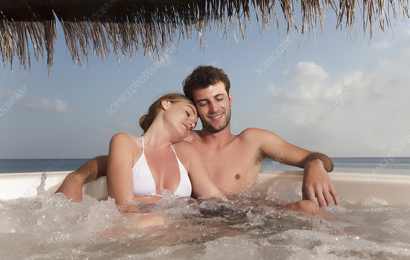 Couple embracing in hot tub