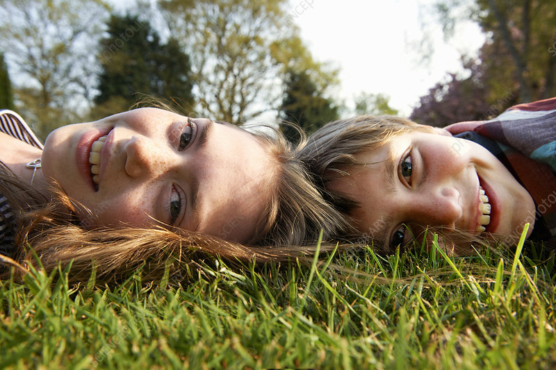 Children laying in grass together