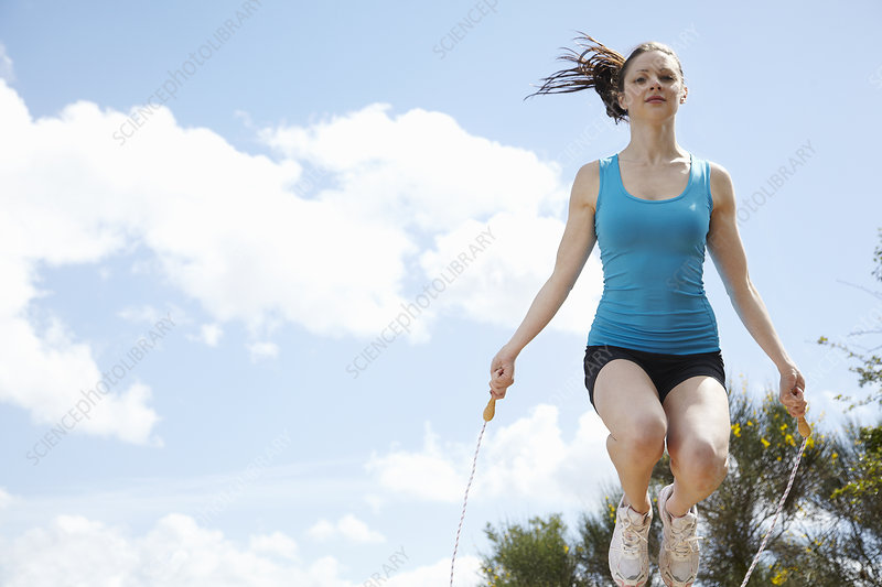 Woman jumping rope outdoors