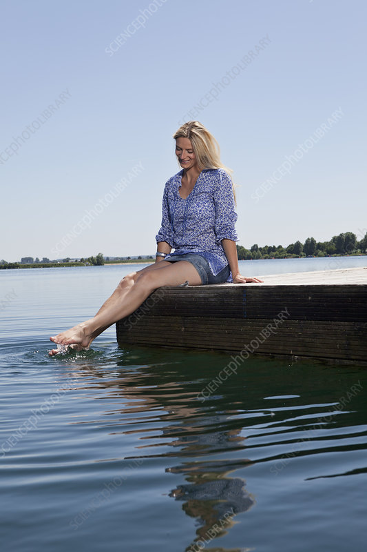 Woman relaxing on dock