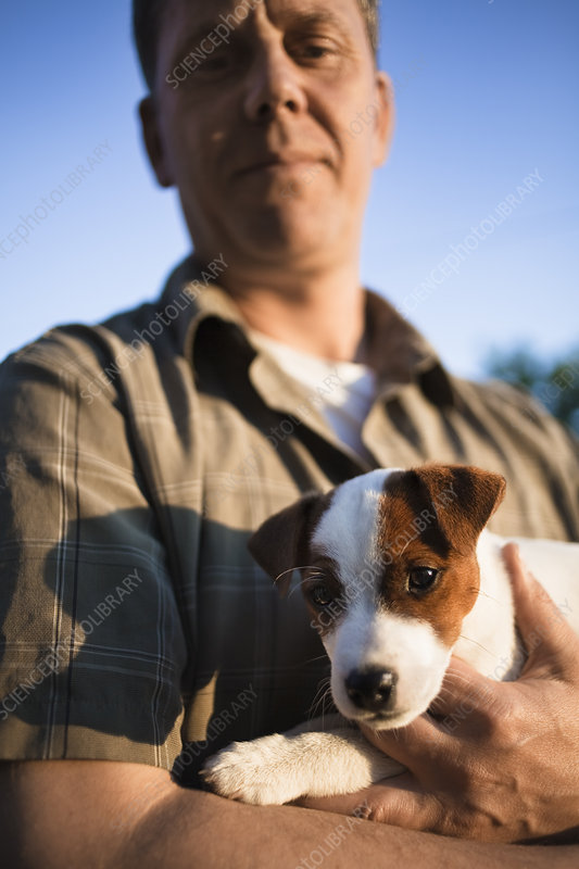 Man holding puppy