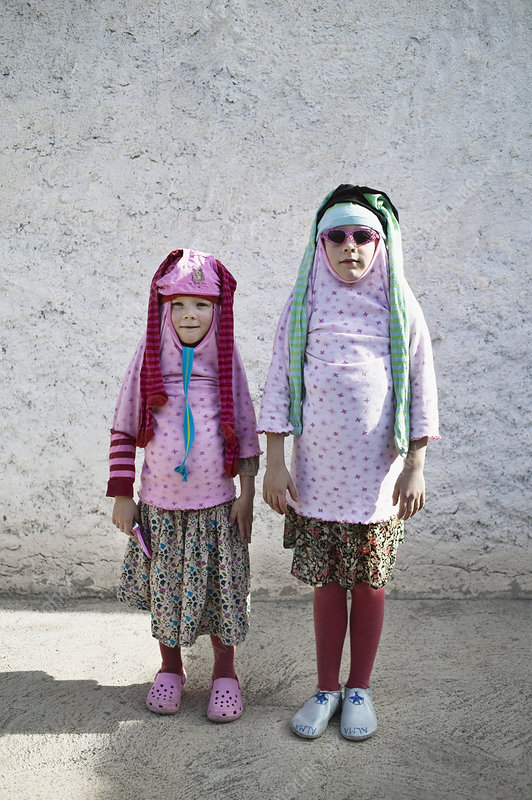 Children playing dress up outdoors