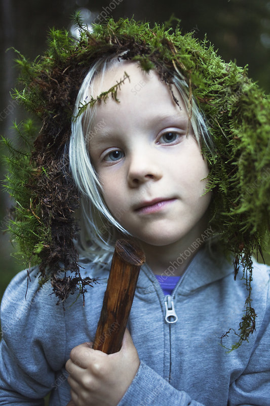 Girl wearing moss on her head outdoors