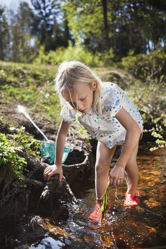 Girl playing in creek