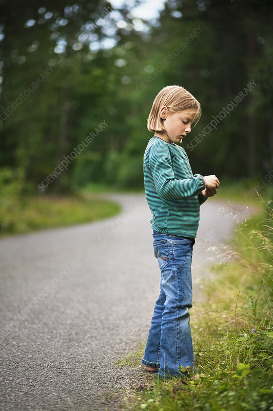 Girl walking along rural road