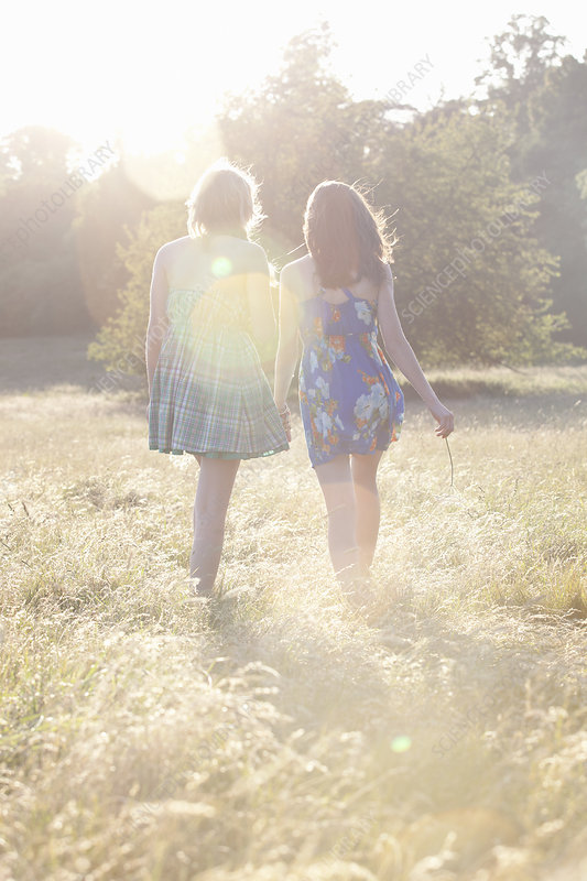 Girls walking together in field