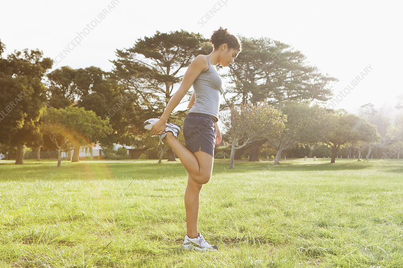Runner stretching in field