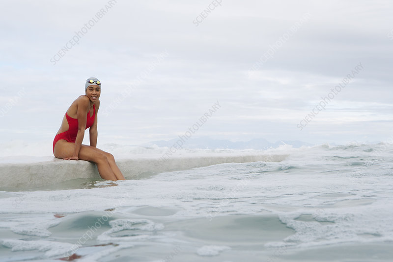 Runner sitting on dock by water