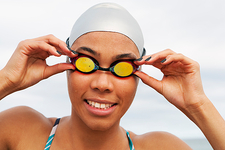 Smiling runner in goggles and swim cap