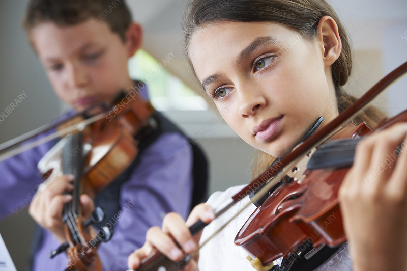 Serious children playing violin