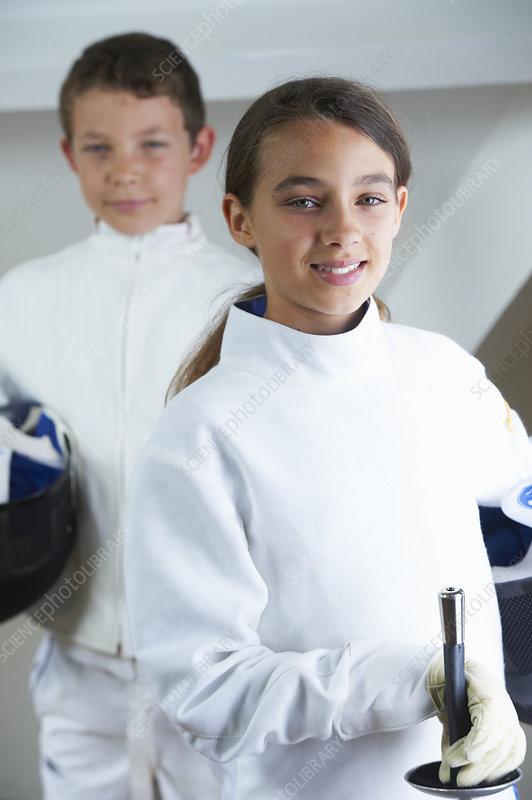 Children wearing fencing costumes