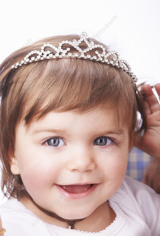 Baby girl wearing diamond tiara