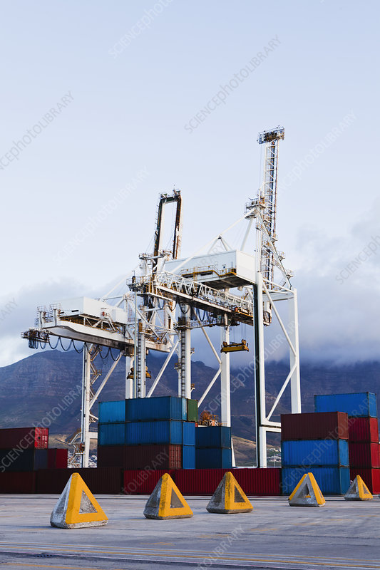 Containers and cranes in shipyard