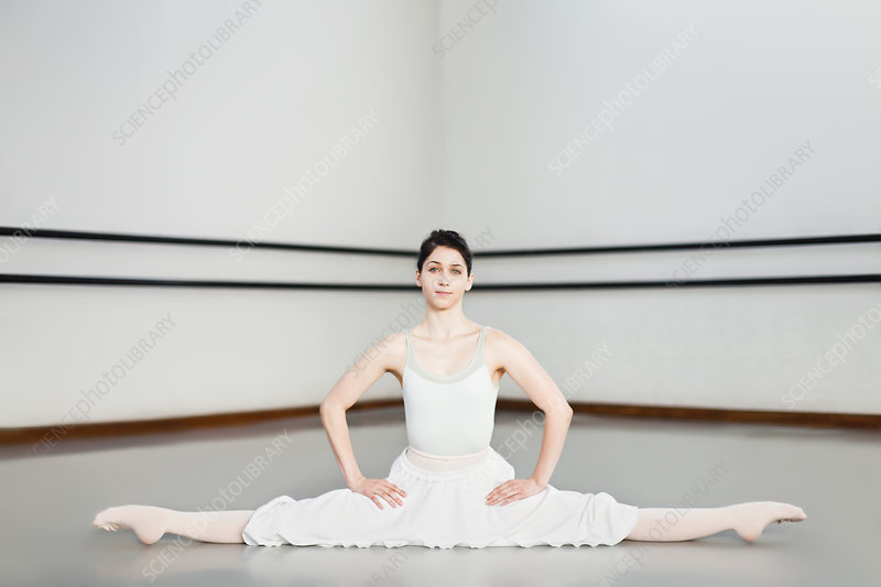 Ballet dancer doing splits in studio