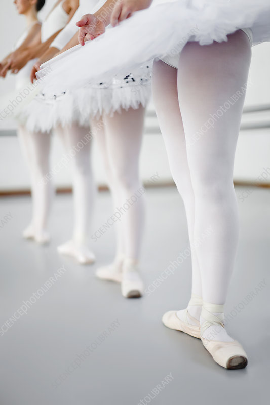 Ballet dancers standing in studio
