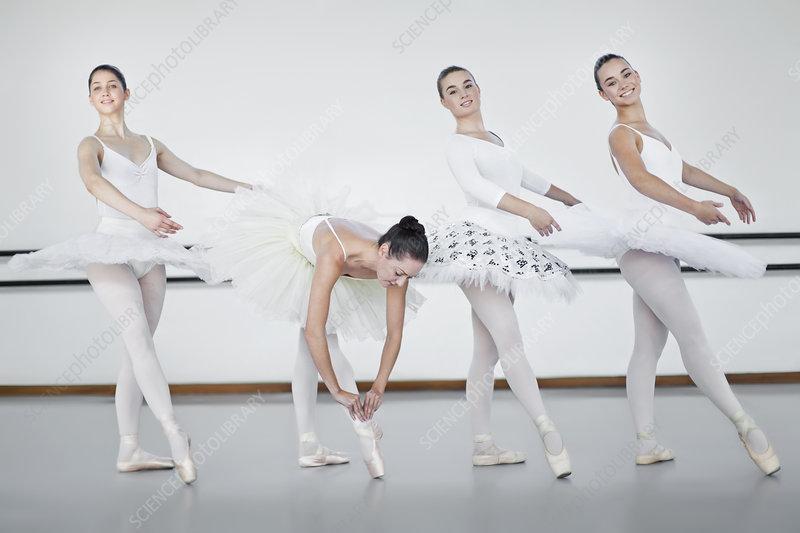 Ballet dancers standing in studio