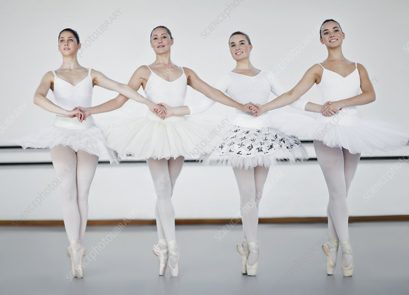 Ballet dancers holding hands in studio