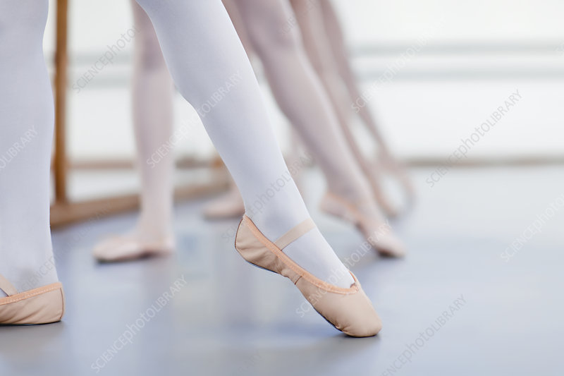 Close up of ballet dancers' feet
