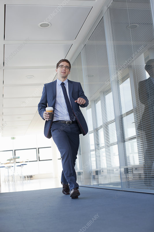 Businessman walking in empty office