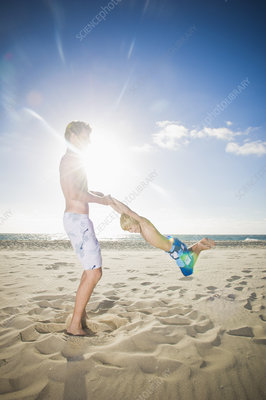 Father and son playing on beach