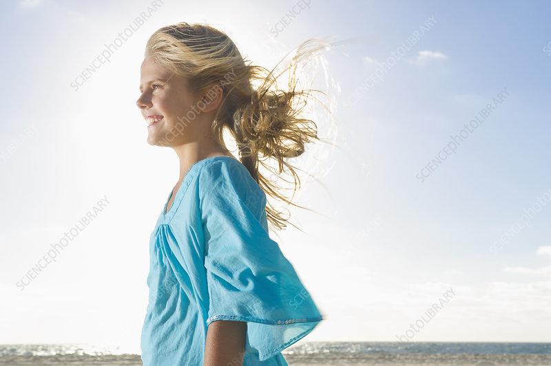 Girl smiling on beach