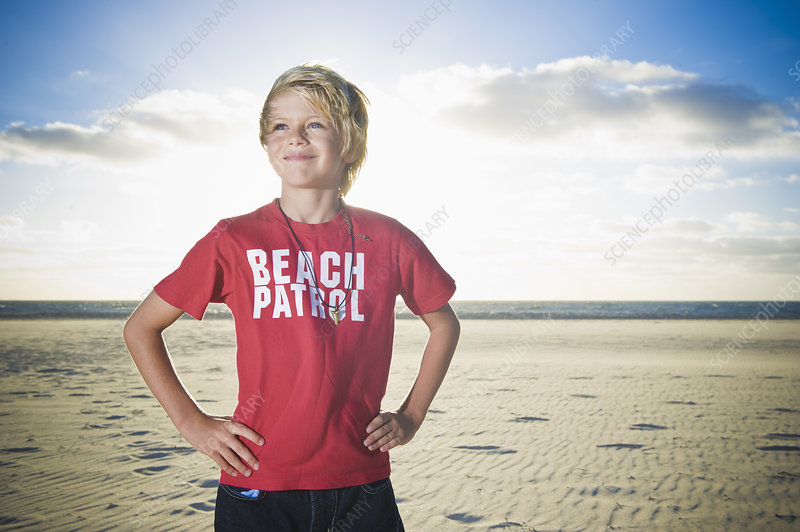 Boy wearing patrol shirt on beach