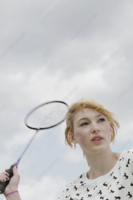Girl playing badminton outdoors