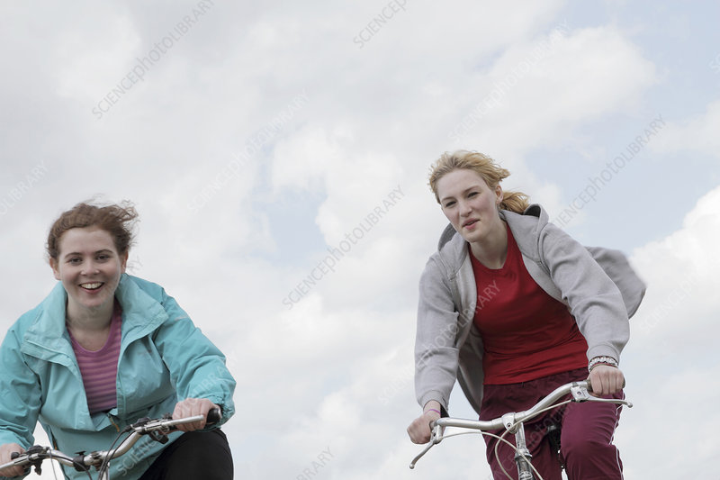 Girls riding bikes outdoors
