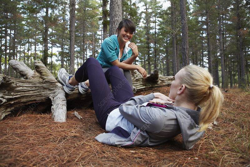 Women exercising together in forest