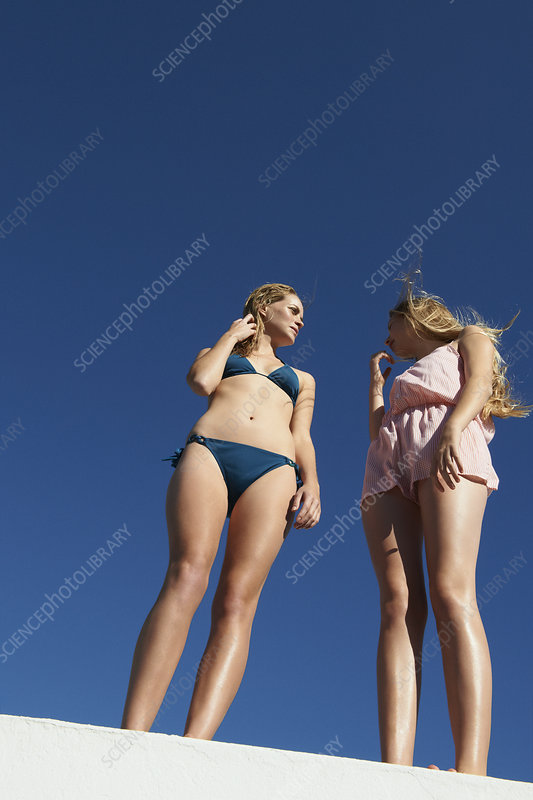 Women standing on wall outdoors