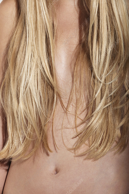 Woman's hair covering her breasts