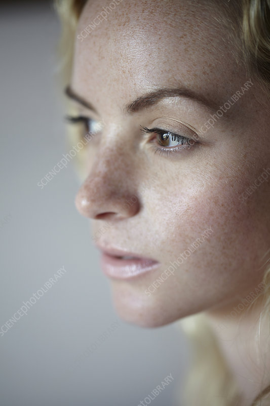 Close up of woman's freckled face