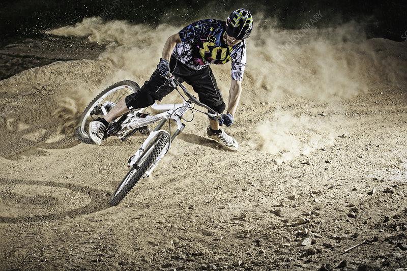 Dirt biker riding on path