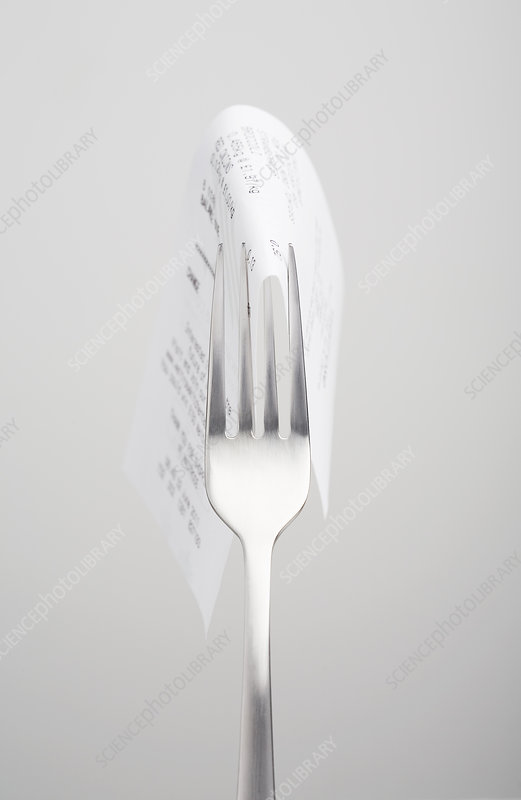 Close up of receipt on fork