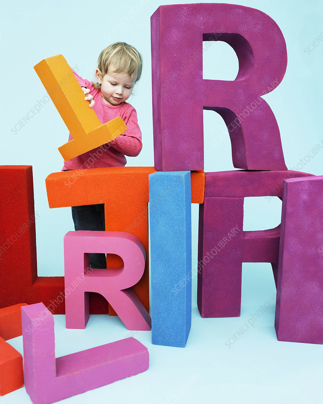 Toddler playing with oversize letters