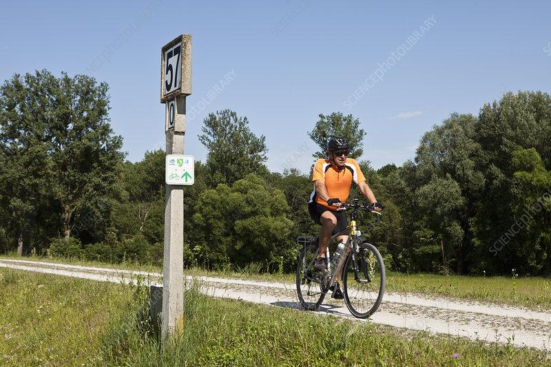 Man biking on dirt road