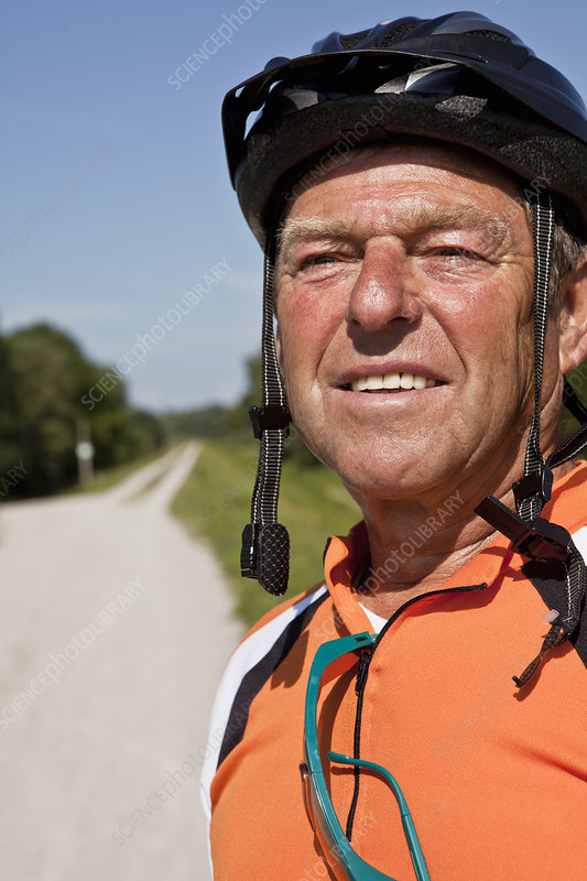 Older man wearing bike helmet