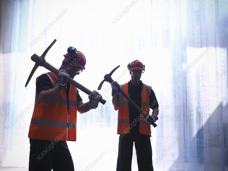 Workers holding pickaxes