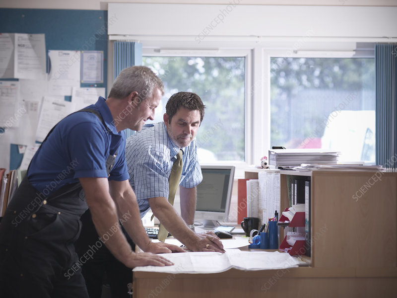 Businessman and worker in office
